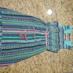 Beautiful like new printed belted hi low dress
